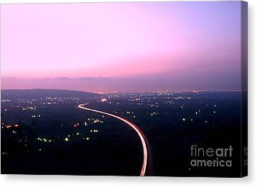 Aerial View Of Highway At Dusk Canvas Print by Yali Shi