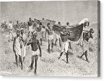 African Porters Carrying Henry Morton Canvas Print by Vintage Design Pics