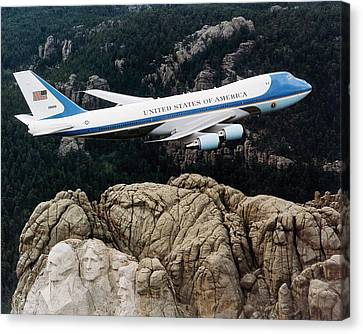 Air Force One Flying Over Mount Rushmore Canvas Print by War Is Hell Store