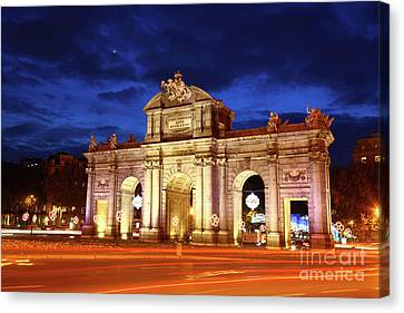 Alcala Gate Monument Madrid Spain Canvas Print by James Brunker