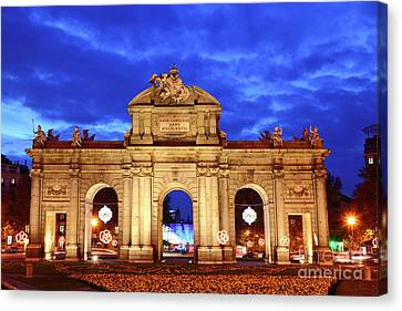 Alcala Gateway At Blue Hour Madrid Canvas Print by James Brunker