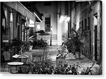 Alley Dining Canvas Print by John Rizzuto