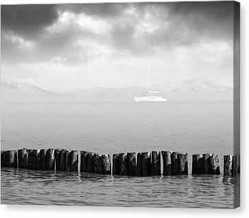 Along The Breakwater Canvas Print by Wim Lanclus