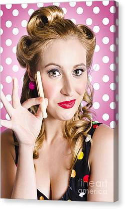 Amercian Pinup Girl With Laundry Peg Canvas Print by Jorgo Photography - Wall Art Gallery