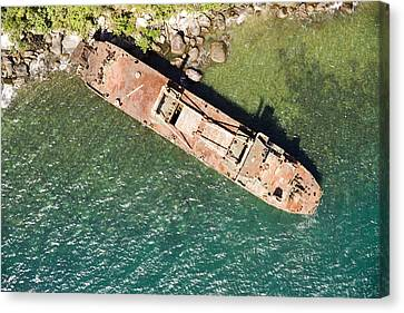 An Abandoned Cargo Ship On Nosy Mangabe Canvas Print by Michael Fay