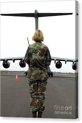 An Airfield Manager Greets An Arriving Canvas Print by Stocktrek Images