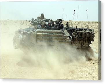 An Amphibious Assault Vehicle Kicks Canvas Print by Stocktrek Images