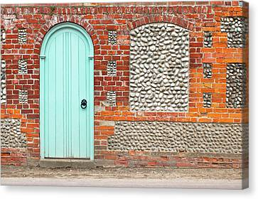 An Arch Door Canvas Print by Tom Gowanlock
