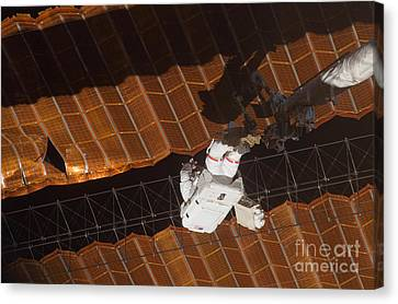 An Astronaut Anchored To A Foot Canvas Print by Stocktrek Images