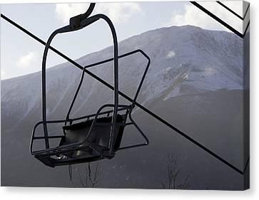An Empty Chair Lift At A Ski Resort Canvas Print by Tim Laman