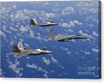 An F-15 Eagle And Two F-22 Raptors Fly Canvas Print by HIGH-G Productions