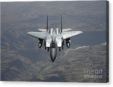 An F-15e Strike Eagle Flies Watch Canvas Print by Stocktrek Images