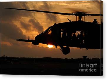 An Hh-60g Pave Hawk Helicopter Prepares Canvas Print by Stocktrek Images