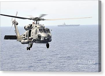 An Mh-60r Seahawk Helicopter In Flight Canvas Print by Stocktrek Images