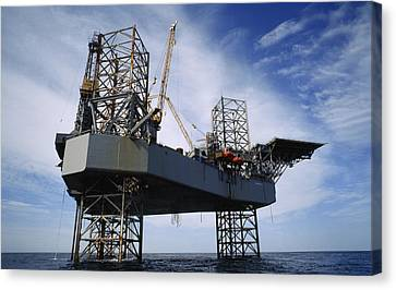 An Oil And Gas Drilling Platform Canvas Print by Justin Guariglia