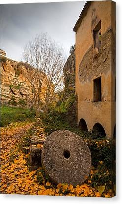 An Old Mill Wheel Outside An Old Flour Canvas Print by Panoramic Images