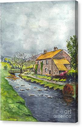 An Old Stone Cottage In Great Britain Canvas Print by Carol Wisniewski