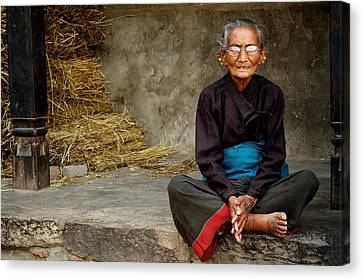An Old Woman In Bhaktapur Canvas Print by Valerie Rosen