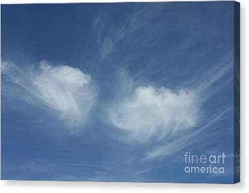 Angel Wings In The Sky Canvas Print by Carol Groenen