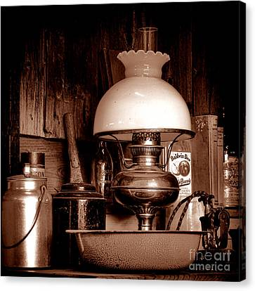 Antique Kerosene Lamp In A Kitchen Canvas Print by Olivier Le Queinec