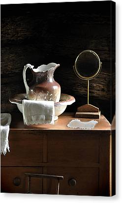 Antique Water Pitcher On Bureau Canvas Print by Rebecca Brittain