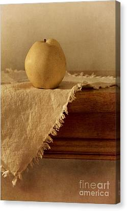 Apple Pear On A Table Canvas Print by Priska Wettstein
