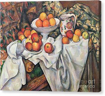 Apples And Oranges Canvas Print by Paul Cezanne