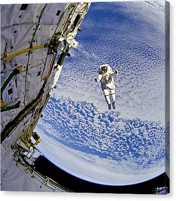 Astronaut In Atmosphere Canvas Print by The  Vault - Jennifer Rondinelli Reilly