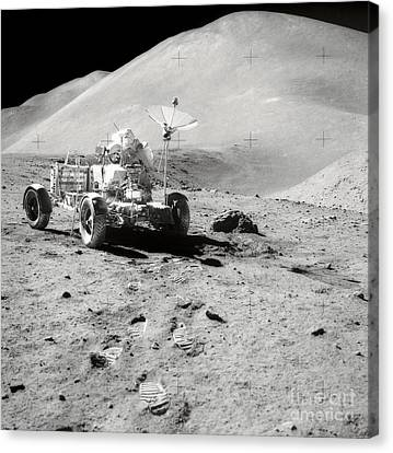 Astronaut Works At The Lunar Roving Canvas Print by Stocktrek Images