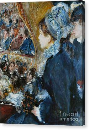 At The Theater Canvas Print by Pierre Auguste Renoir