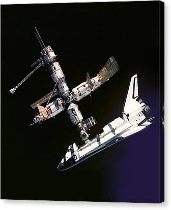 Atlantis Shuttle Docked To Space Station Canvas Print by Daniel Hagerman