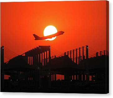 B747 Sunset Take-off Canvas Print by Graham Taylor