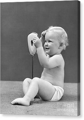 Baby Girl With Hand Mirror, 1940s Canvas Print by H. Armstrong Roberts/ClassicStock