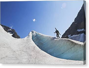 Backcountry Skier Above The Eklutna Canvas Print by Joe Stock