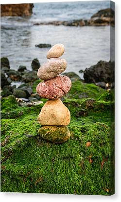 Balancing Zen Stones By The Sea Iv Canvas Print by Marco Oliveira