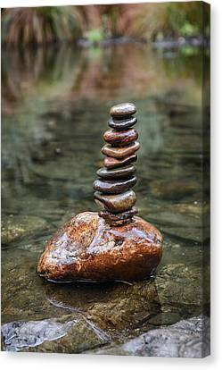 Balancing Zen Stones In Countryside River IIi Canvas Print by Marco Oliveira