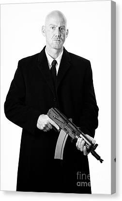 Bald Headed Man Wearing Heavy Black Overcoat Holding Ak-47 Canvas Print by Joe Fox