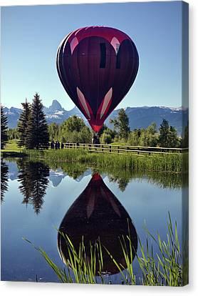 Balloon Reflection Canvas Print by Leland D Howard