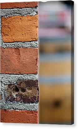Barrel Behind Bricks Canvas Print by Lisa Knechtel