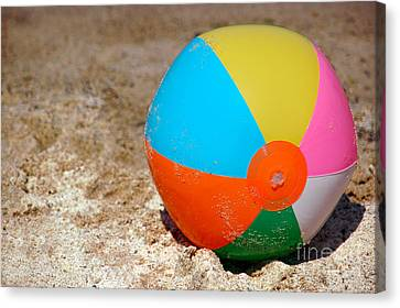 Beach Ball On Sand With Copy Space Canvas Print by Paul Velgos