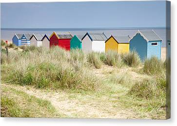 Beach Huts Canvas Print by Ian Merton