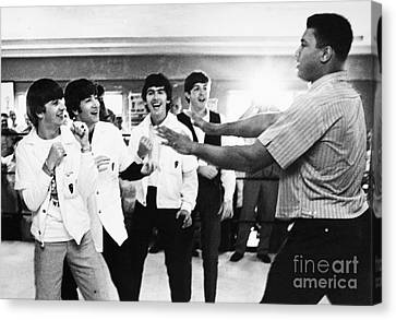 Beatles And Clay, 1964 Canvas Print by Granger