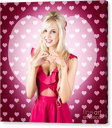 Beautiful Blonde Woman Gesturing Heart Shape Canvas Print by Ryan Jorgensen