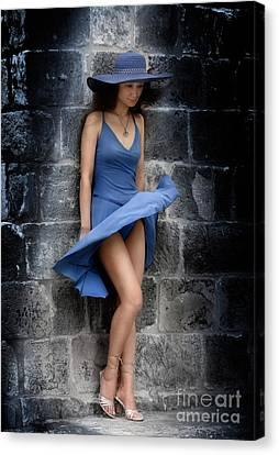 Beautiful Romantic Woman Standing Near A Stone Wall Canvas Print by Oleksiy Maksymenko