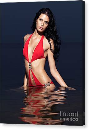 Beautiful Young Woman In Red Swimsuit Standing In Water Canvas Print by Oleksiy Maksymenko