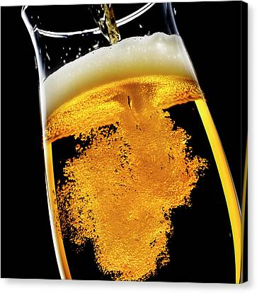 Beer Been Poured Into Glass, Studio Shot Canvas Print by Ultra.f