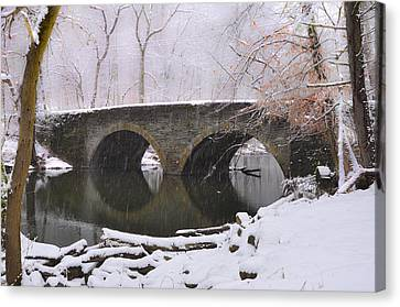 Bells Mill Bridge In A Snow Storm Canvas Print by Bill Cannon