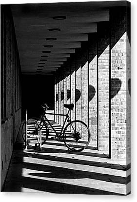 Bicycle And Shadows Canvas Print by George Morgan