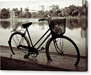 Bicycle By The Lake Canvas Print by Dave Bowman