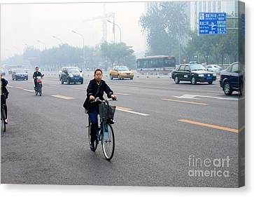 Bicyclist In Beijing Canvas Print by Thomas Marchessault